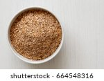 wheat bran  in white ceramic... | Shutterstock . vector #664548316