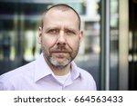 headshot portrait of middle... | Shutterstock . vector #664563433
