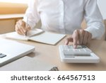 female accountant calculations... | Shutterstock . vector #664567513