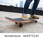 young woman skateboarder... | Shutterstock . vector #664572124