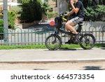 A Men Riding An Electric...