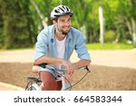 Handsome Young Man With Bicycl...