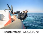 scuba diver jumping in the... | Shutterstock . vector #664611070
