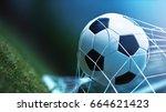soccer ball in goal on green... | Shutterstock . vector #664621423