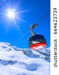 sunshine over cable car to... | Shutterstock . vector #664623739