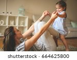 young mother playing with her... | Shutterstock . vector #664625800