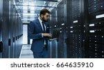 it engineer in data center... | Shutterstock . vector #664635910
