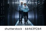 in data center two it engineers ... | Shutterstock . vector #664639264