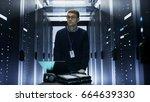 shot of server engineer pushing ... | Shutterstock . vector #664639330