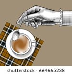 woman's hand with a coffee cup... | Shutterstock .eps vector #664665238