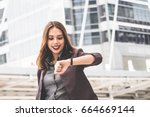business woman looking at watch ... | Shutterstock . vector #664669144