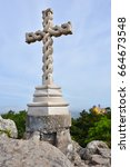 Small photo of Cruz Alta or High Cross stands at the highest point in the Sintra hills in park of Sintra. Pena Palace castle at background