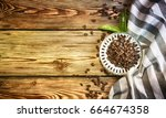 coffee on the wooden table | Shutterstock . vector #664674358