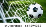 soccer ball in goal on green... | Shutterstock . vector #664694383