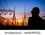 Electricity Workers And Pylon...