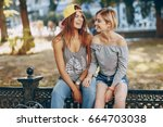 two beautiful girls in stylish... | Shutterstock . vector #664703038