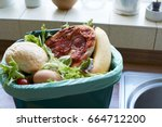 fresh food waste in recycling... | Shutterstock . vector #664712200