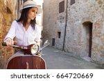beautiful girl in a hat in a... | Shutterstock . vector #664720669