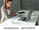 business woman in office | Shutterstock . vector #664720978