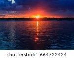 boats  rocky shore  sunset on...   Shutterstock . vector #664722424