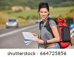 girl holding map with backpack... | Shutterstock . vector #664725856