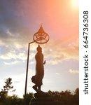 buddha statue under sun light... | Shutterstock . vector #664736308