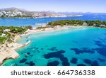 famous astir beach in south... | Shutterstock . vector #664736338
