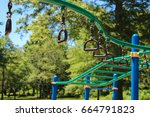 monkey bars and rings at the... | Shutterstock . vector #664791823