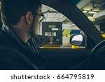 man got ticket from parking... | Shutterstock . vector #664795819