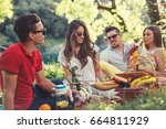 young people having picnic near ... | Shutterstock . vector #664811929