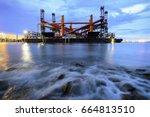 shipyard for maintenance at... | Shutterstock . vector #664813510