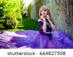 Blonde Girl In Violet Purple...