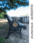 Small photo of April 11, 2017 - Claros, Izmir province, Turkey. Iron bench at Claros, an ancient Greek sanctuary on the coast of Ionia, famous for a temple and oracle of Apollo