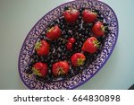 strawberry and black currant in ... | Shutterstock . vector #664830898
