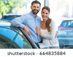 young couple buying a car  | Shutterstock . vector #664835884