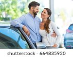 young couple buying a car  | Shutterstock . vector #664835920