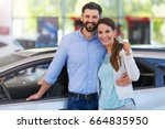 young couple buying a car  | Shutterstock . vector #664835950