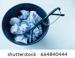 glasses thrown in a bucket of... | Shutterstock . vector #664840444