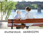 senior woman and her adult... | Shutterstock . vector #664843294