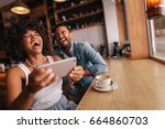 happy man and woman having fun... | Shutterstock . vector #664860703