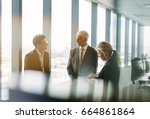 three business colleagues... | Shutterstock . vector #664861864