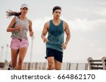 young people running outdoors.... | Shutterstock . vector #664862170