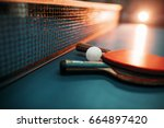 two tennis rackets and ball... | Shutterstock . vector #664897420