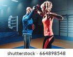 woman on self defense training... | Shutterstock . vector #664898548