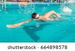 Swimmer In Glasses Swims In...