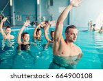 aqua aerobics in water sport... | Shutterstock . vector #664900108