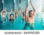 women aqua aerobics class in... | Shutterstock . vector #664900180