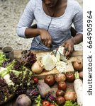 Small photo of People prepare a fresh vegetable
