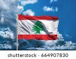 lebanon flag with sky background | Shutterstock . vector #664907830