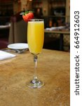 single mimosa cocktail glass ...   Shutterstock . vector #664912603